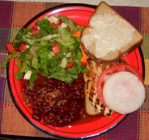 Pounded chicken sandwich with southwestern beans and salad